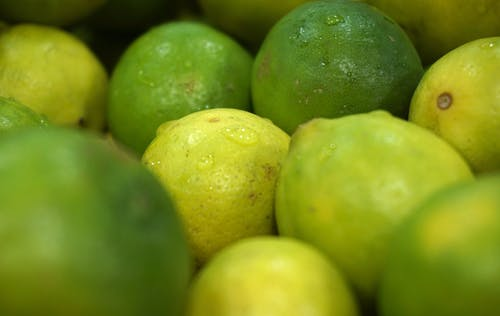 Green and Yellow Lime Fruits in Close-up Photo