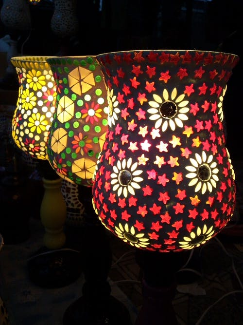 Three Multicolored Floral Table Lamps Turned on
