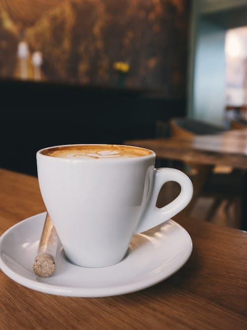 White Ceramic Cup on White Ceramic Saucer With White Espresso Coffe