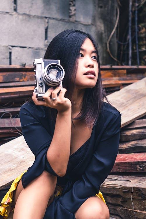 Woman Holding Black Slr Camera