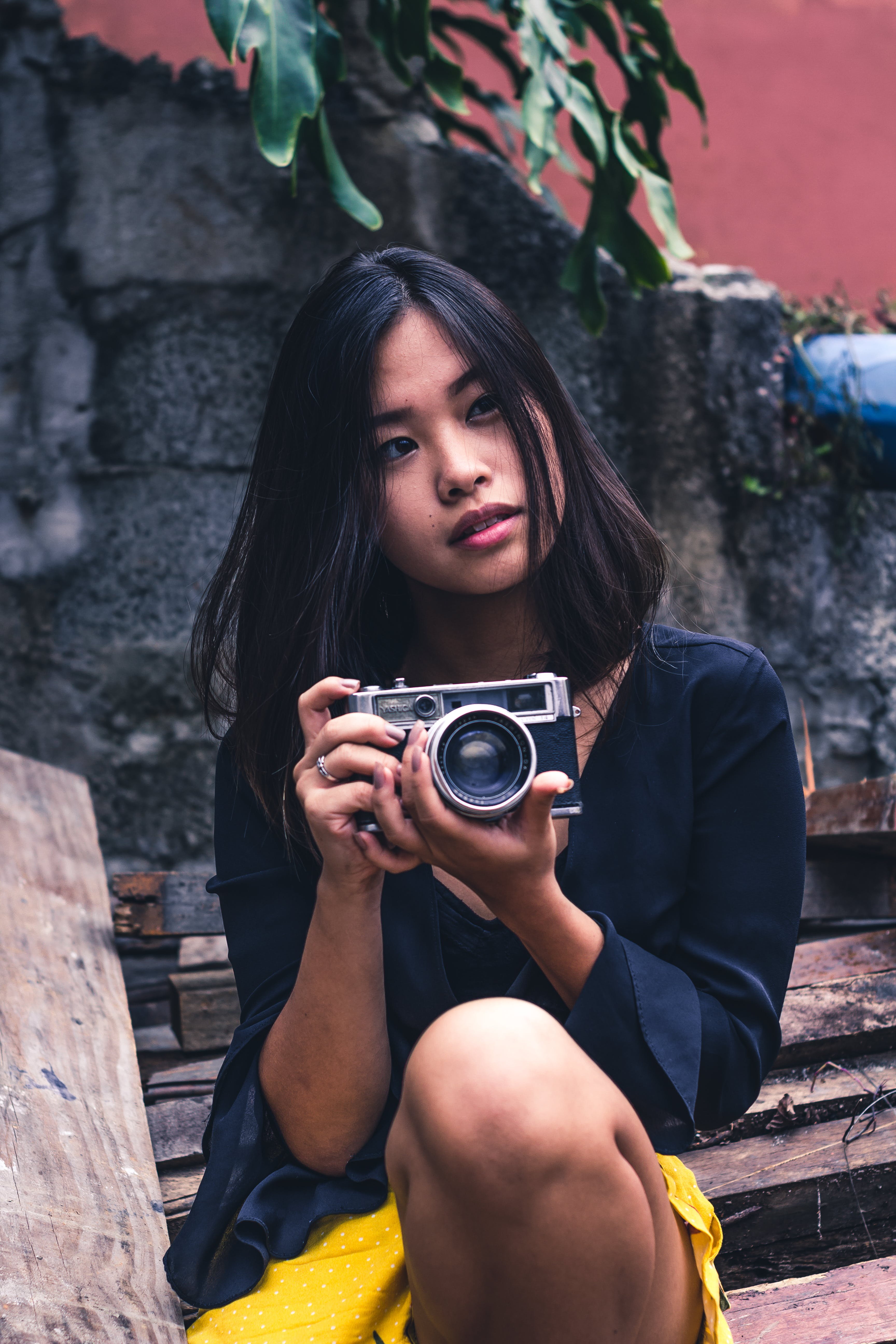 Woman Holding Camera on Both Hands