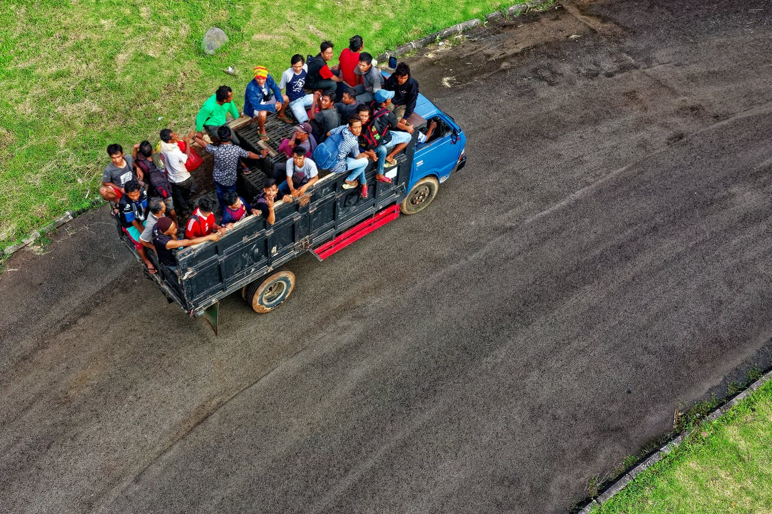 Aerial Photo of People Riding in Truck