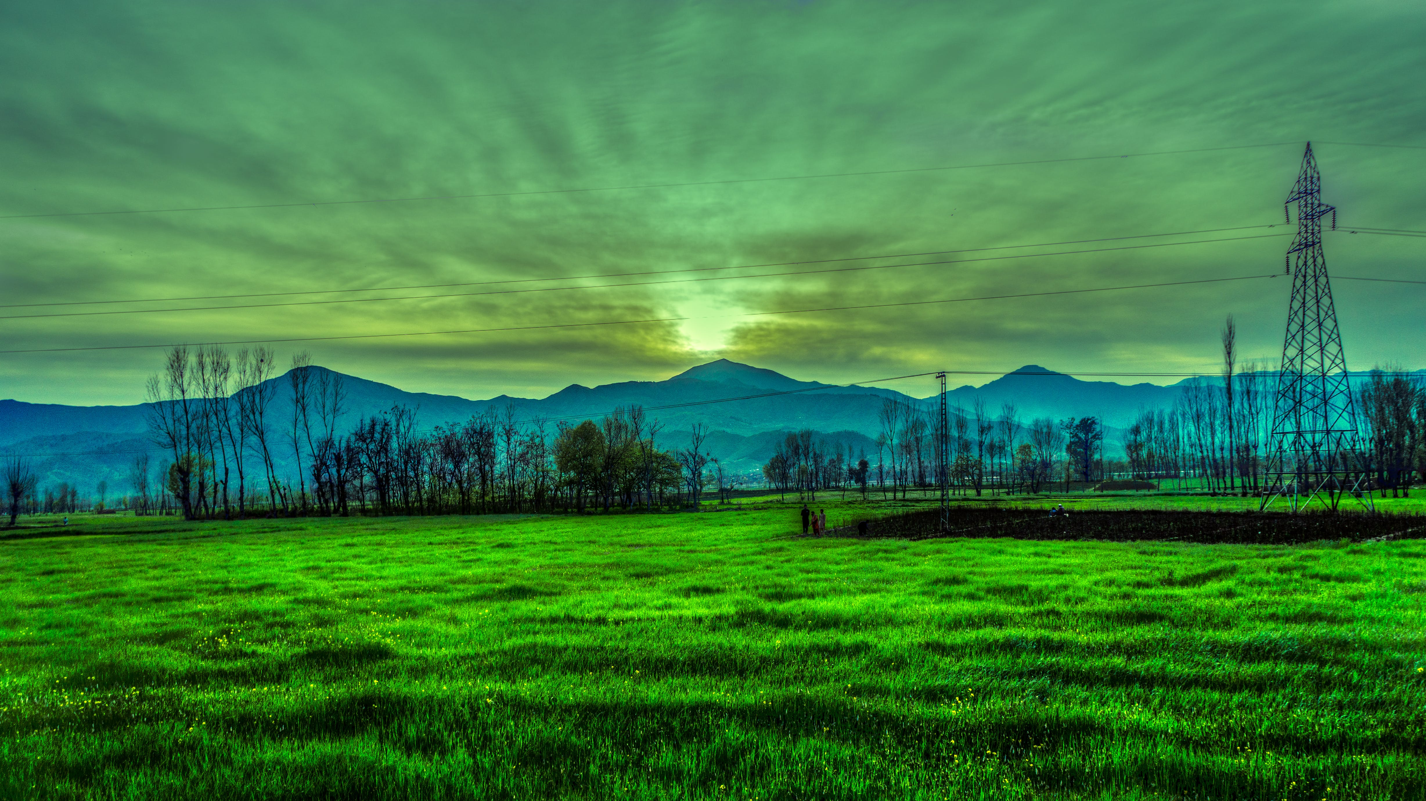 Silhouette Photography of Mountain Near Green Grass