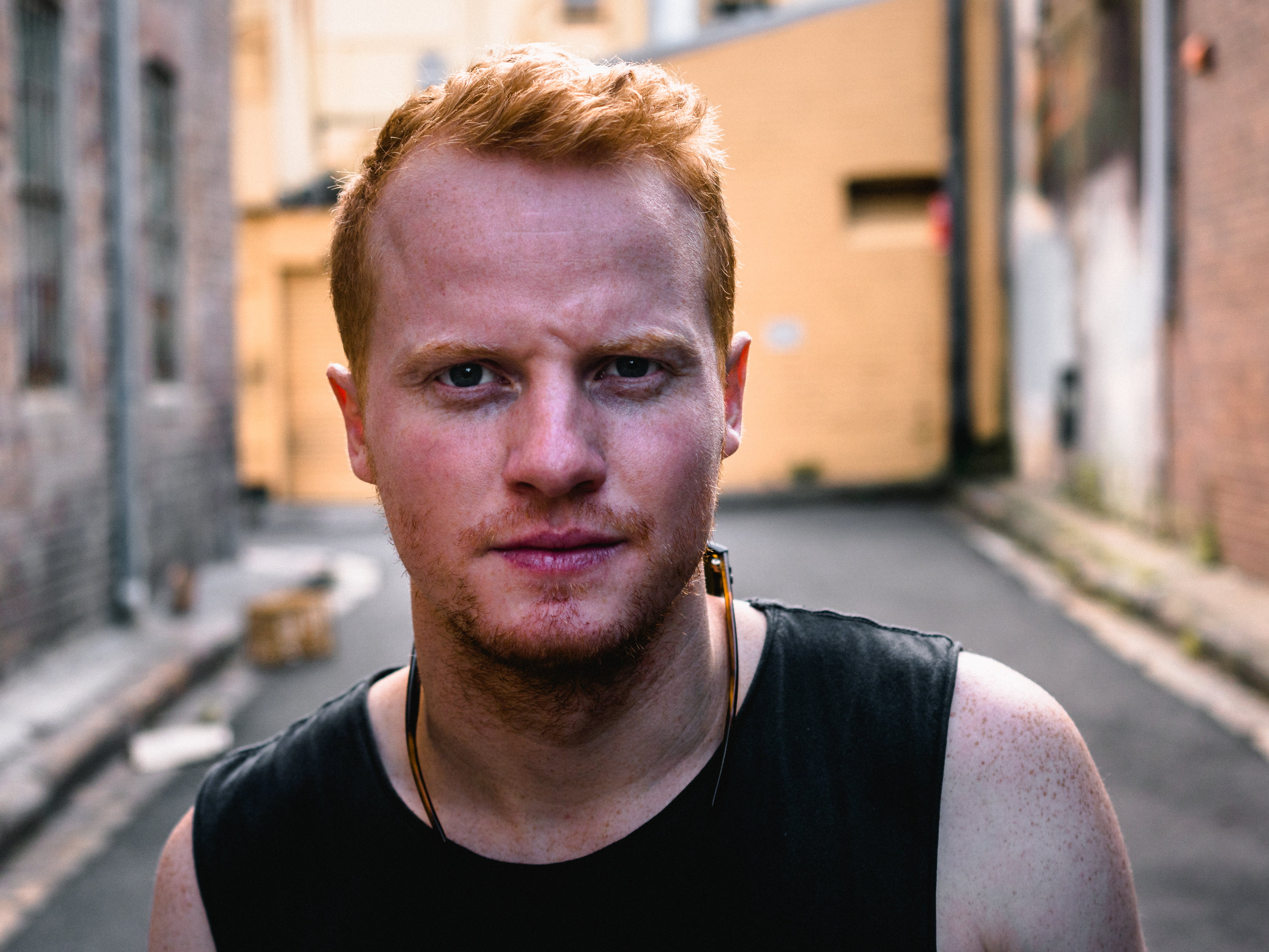 Close-Up Photo of Man Standing in Alley