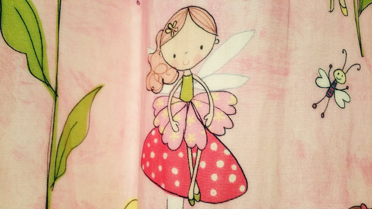 Close-up Photo of Pink and Red Fairy Graphic Textile