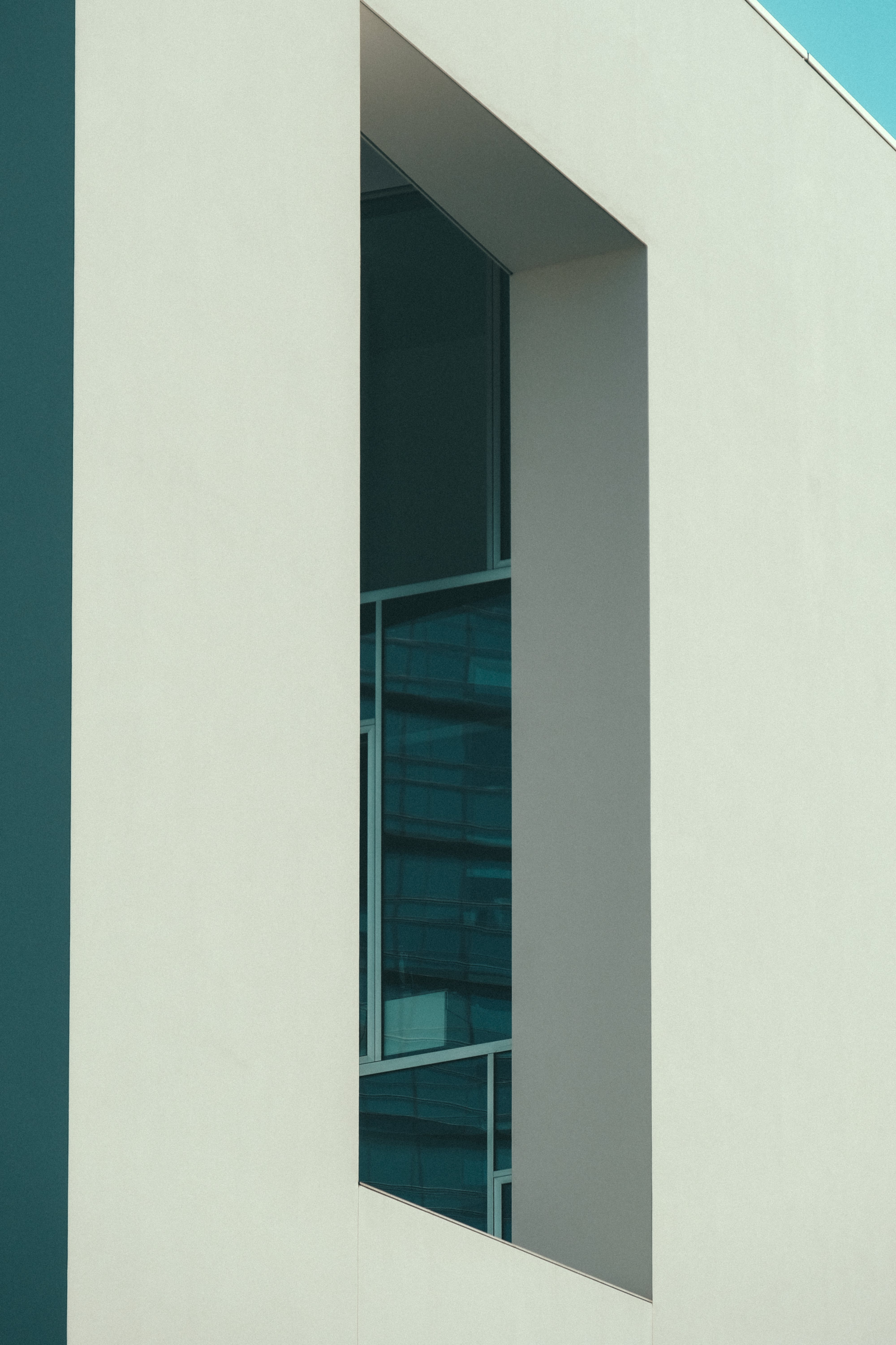 Low-angle Photography White Concrete Building Under Blue Sky