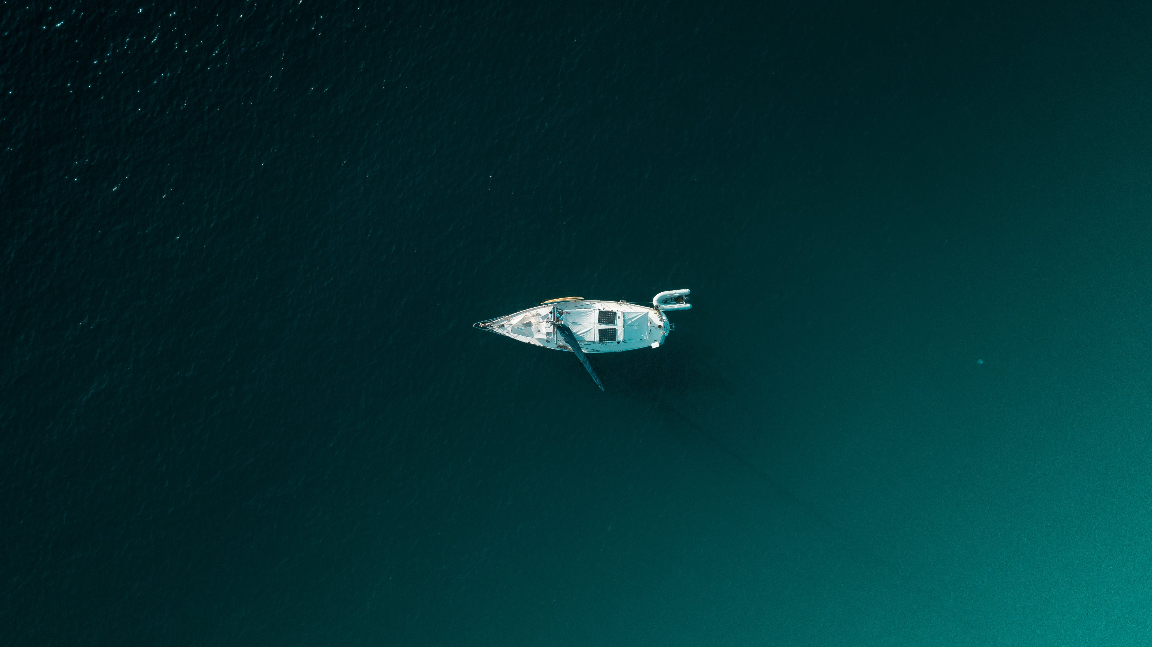 White Boat On Green Water