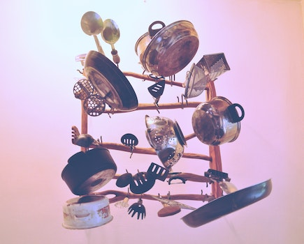 Kitchen Cookware Piled Up on Brown Wooden Rack