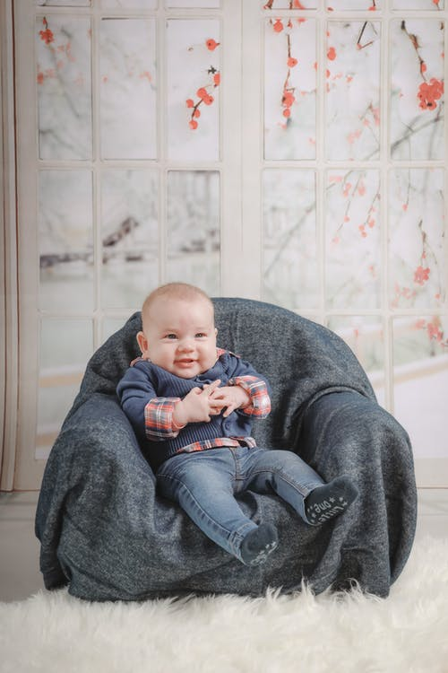 Baby Sitting on Sofa Chair