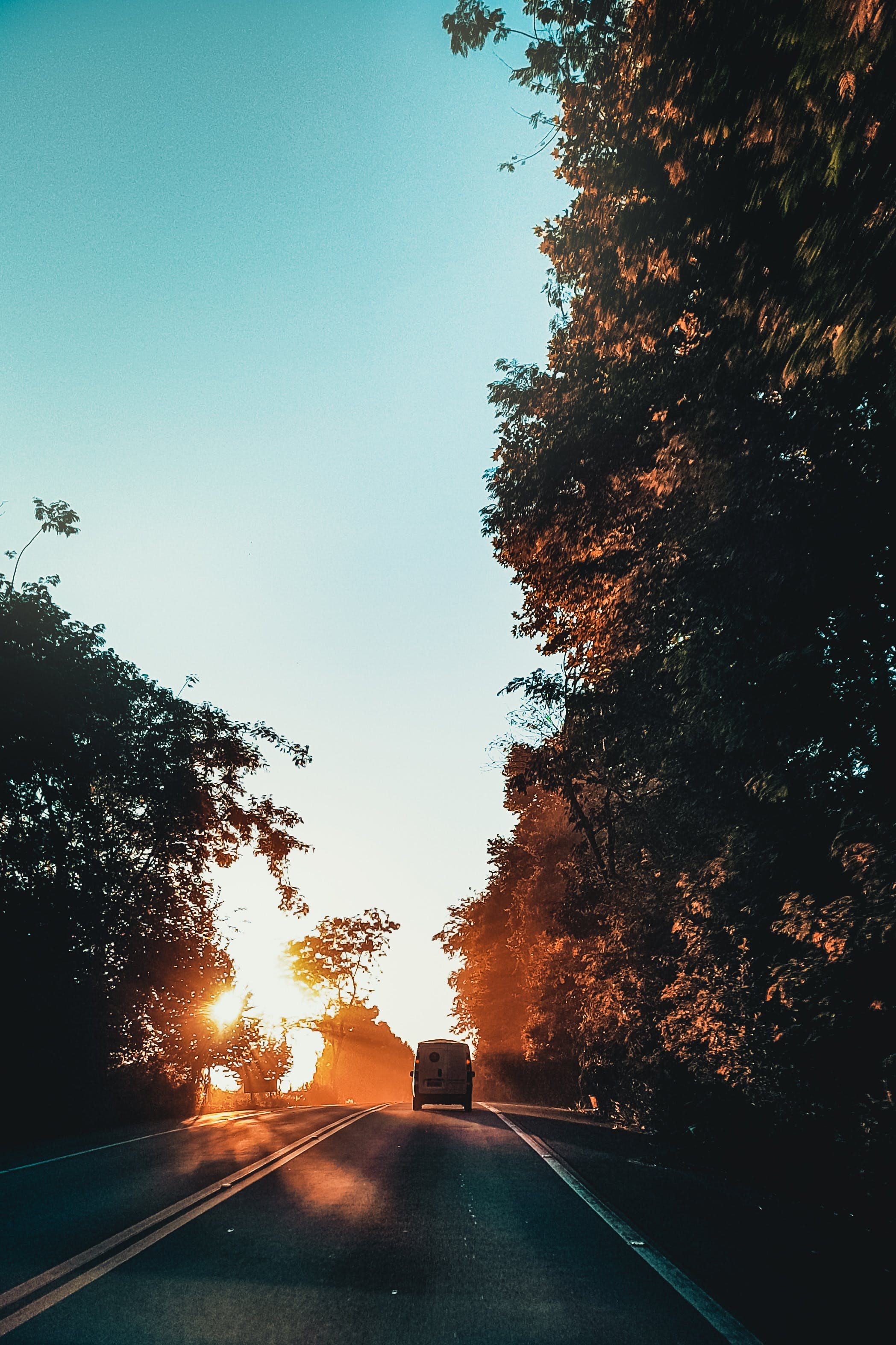 Vehicle On Road During Golden Hour