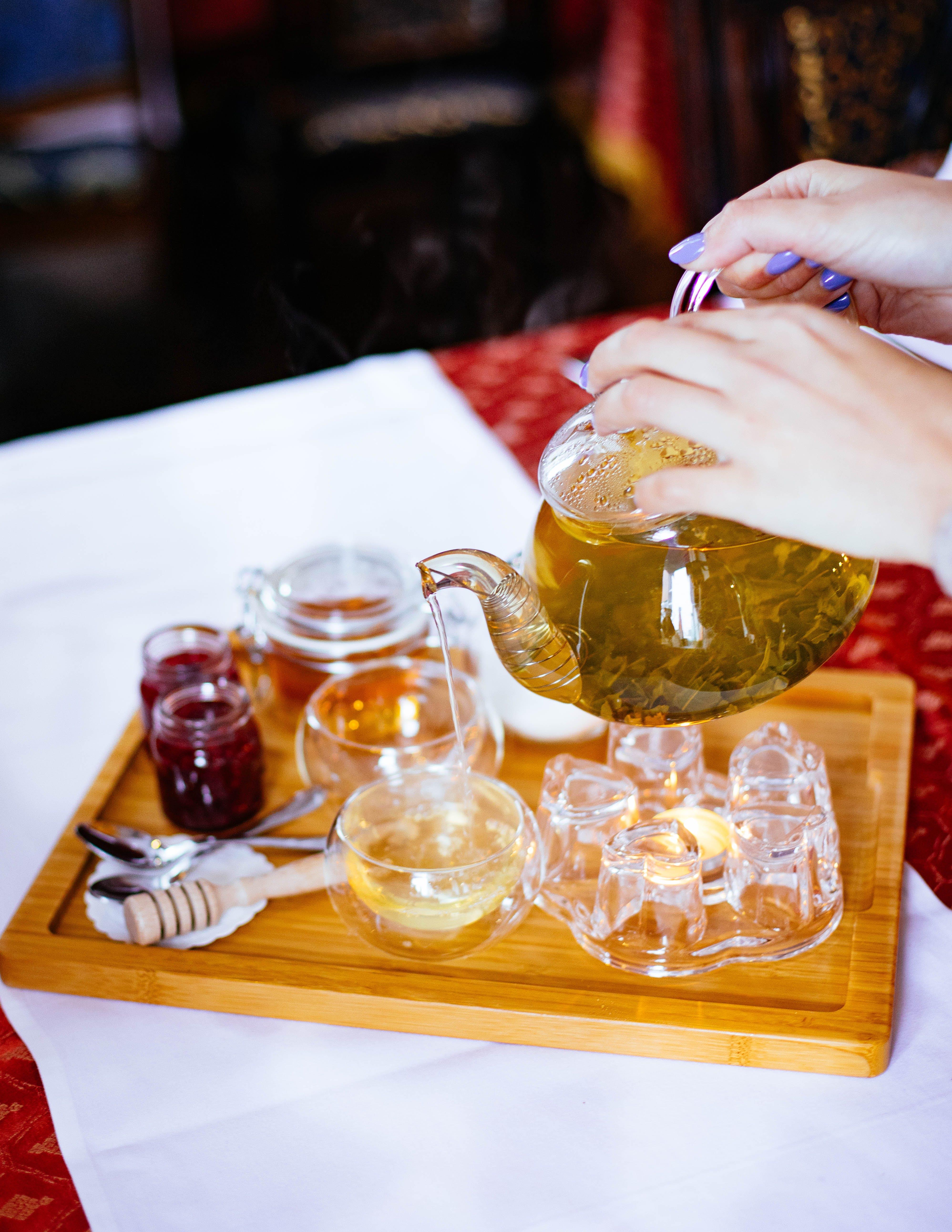 Woman Poring Tea