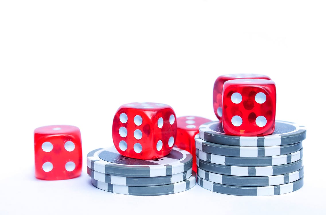 3 Red Dices With Grey and White Poker Chips