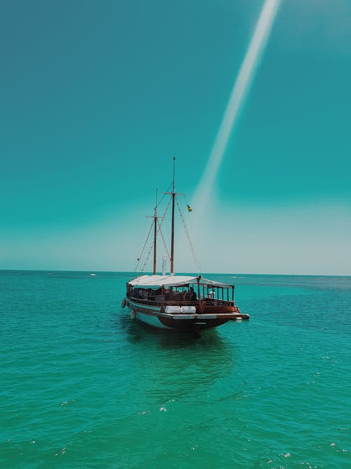 Photo Of Boat On The Ocean