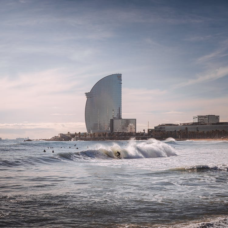 Person Surfing With High-rise Building Background