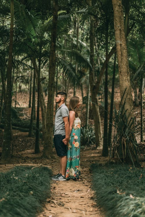 Photo Of Couple Standing In The Middle Of Forest