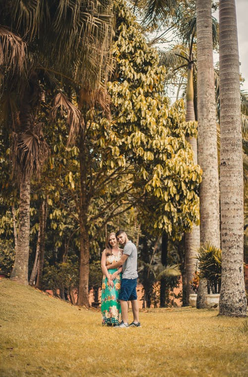 Couple Standing Near Palm Trees
