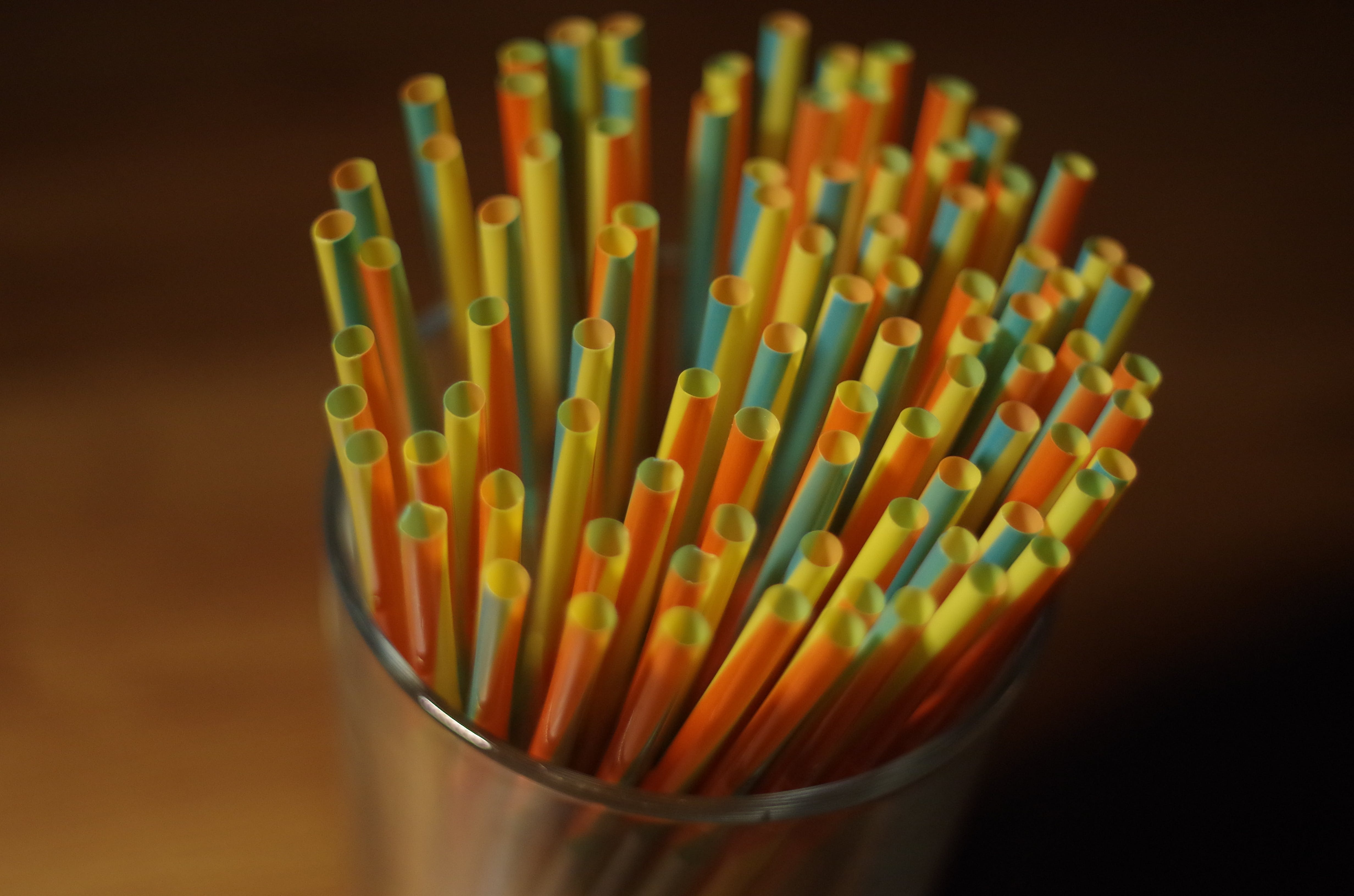 Colorful Plastic Straw on a Glass Container