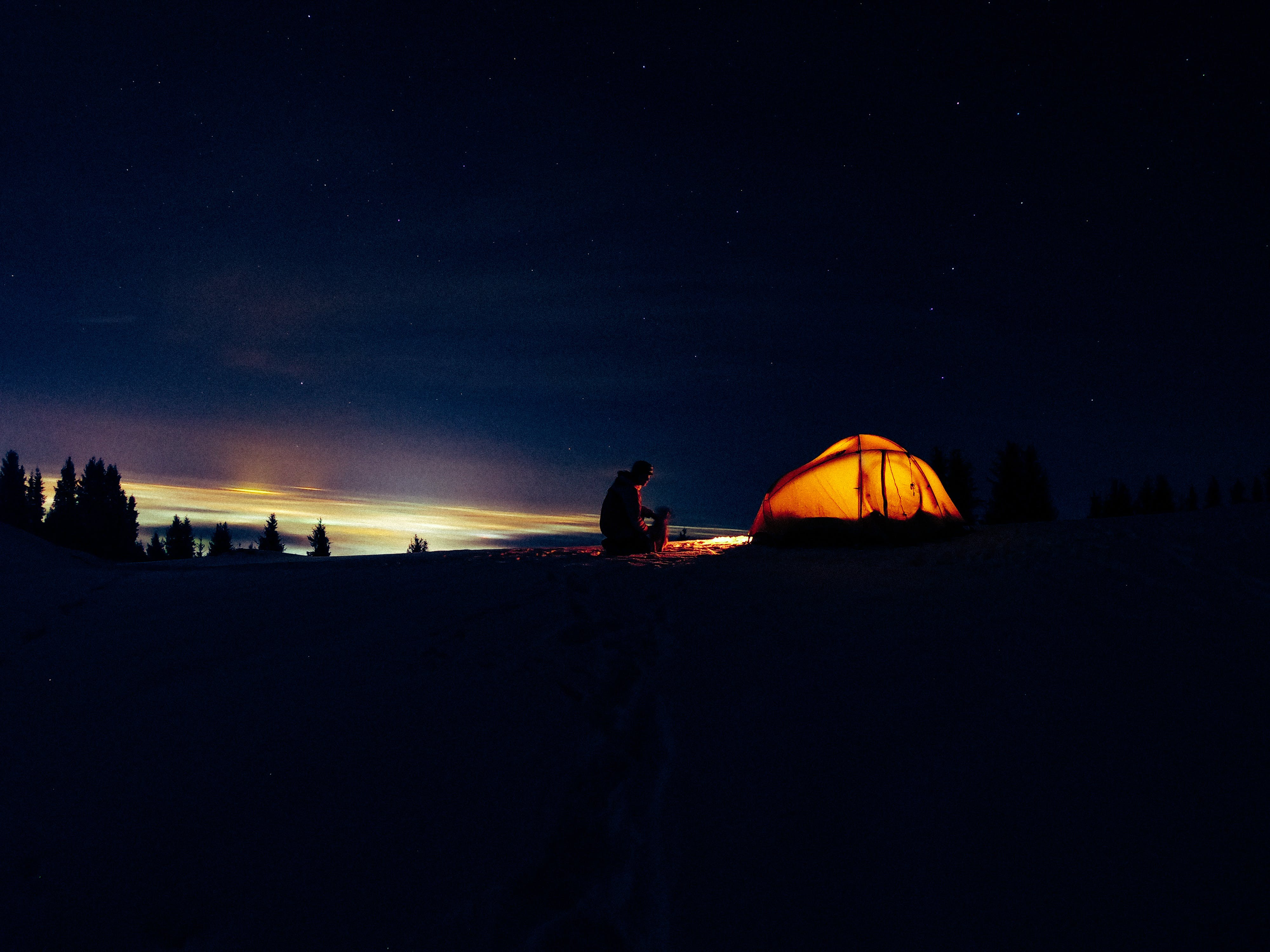 Silhouette Of Man In Front Of Tent