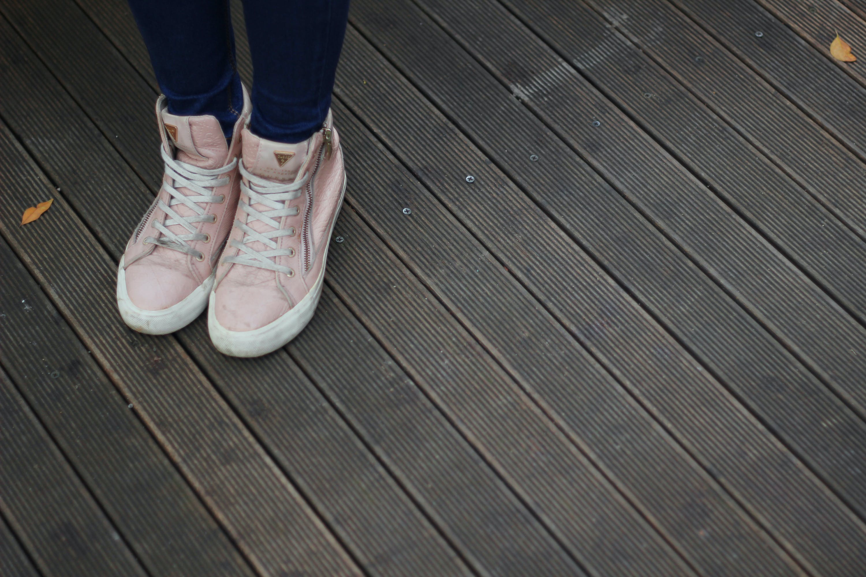 Person Wearing Pink and White High Top Sneakers