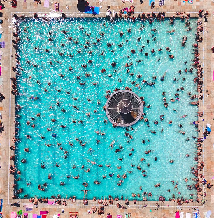 People Swimming At The Pool