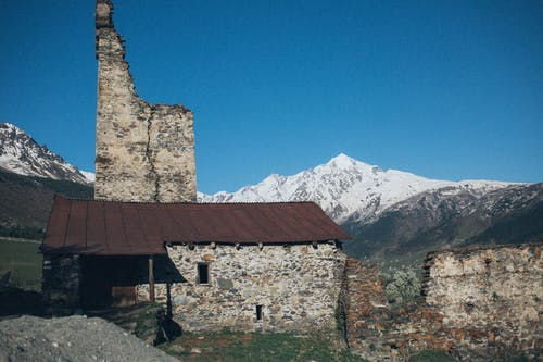 Gray Stone House Near Mountain