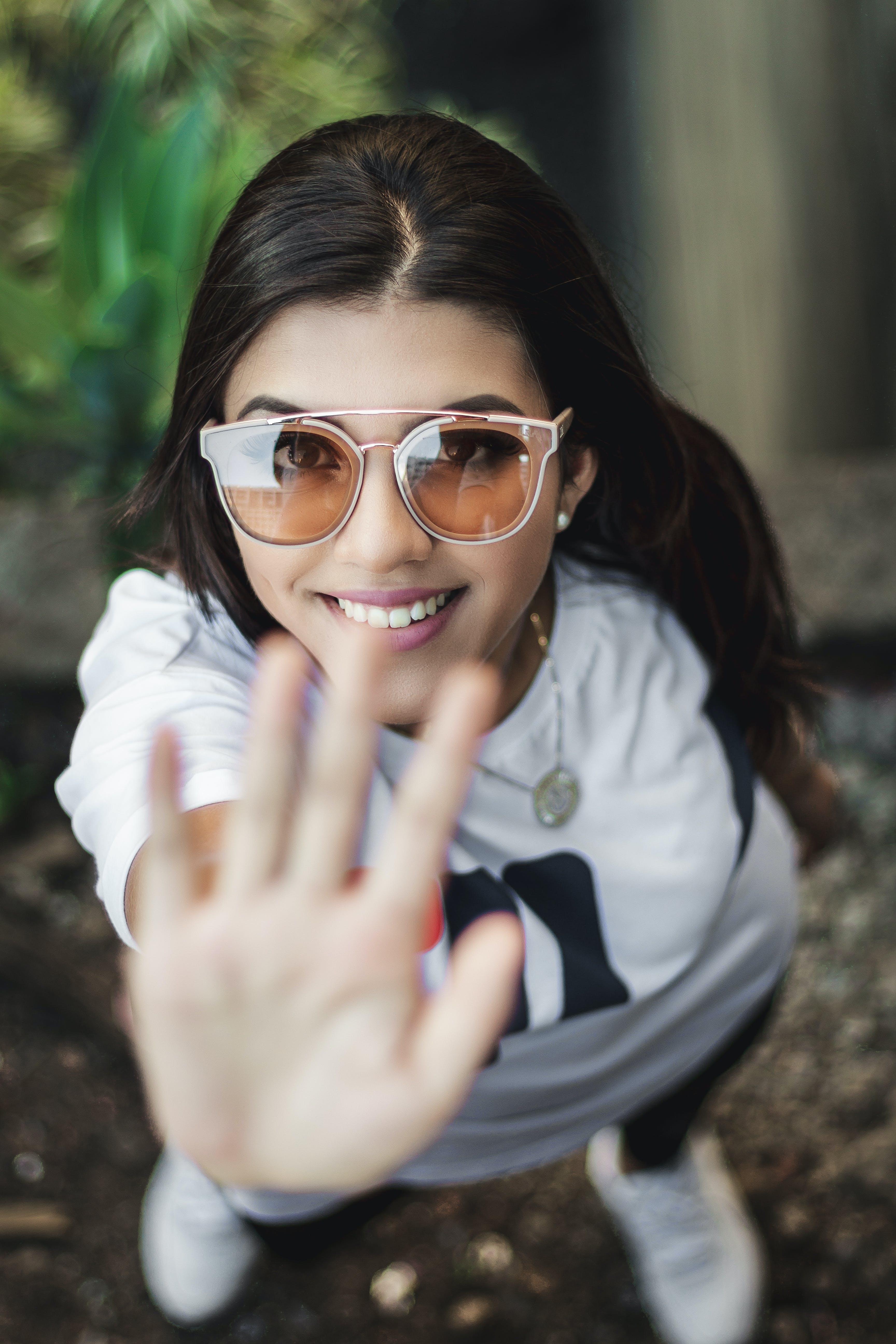 Selective Focus Photography Of Woman Raising Hand