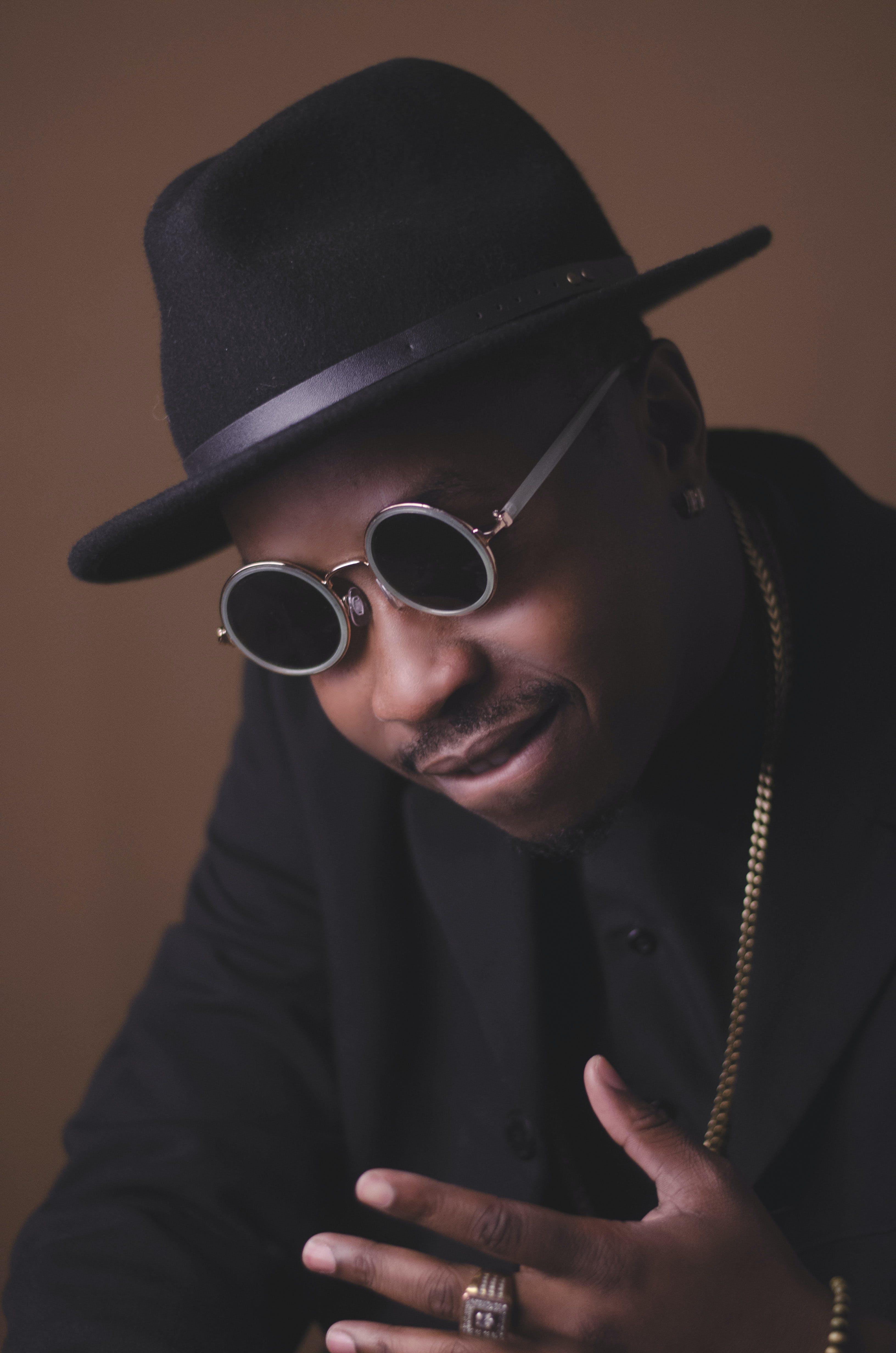 Man Wearing Sunglasses And Black Hat