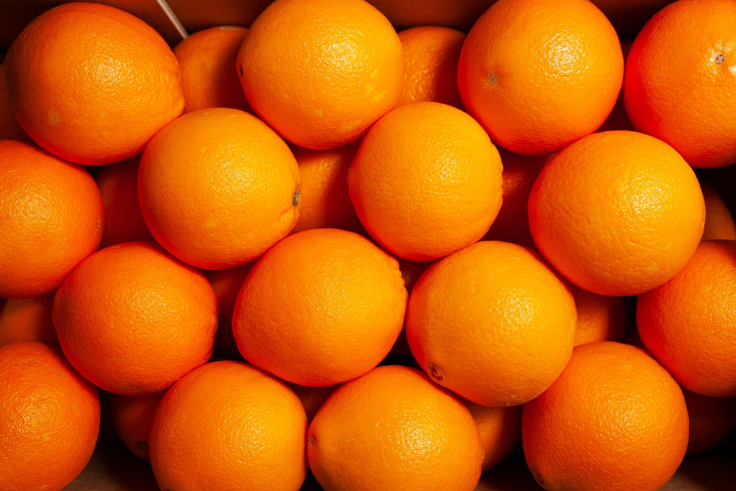 Gratis lagerfoto af appelsiner, appelsinjuice, orange baggrund, orange farve