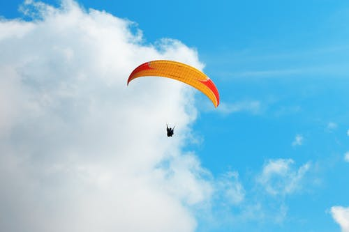 Person Riding Parachute