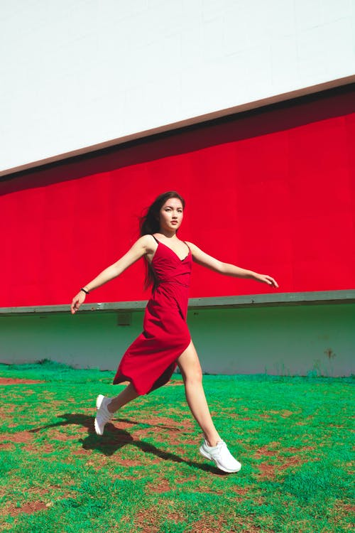 Woman Wearing Red Spaghetti Strap V-neck Dress