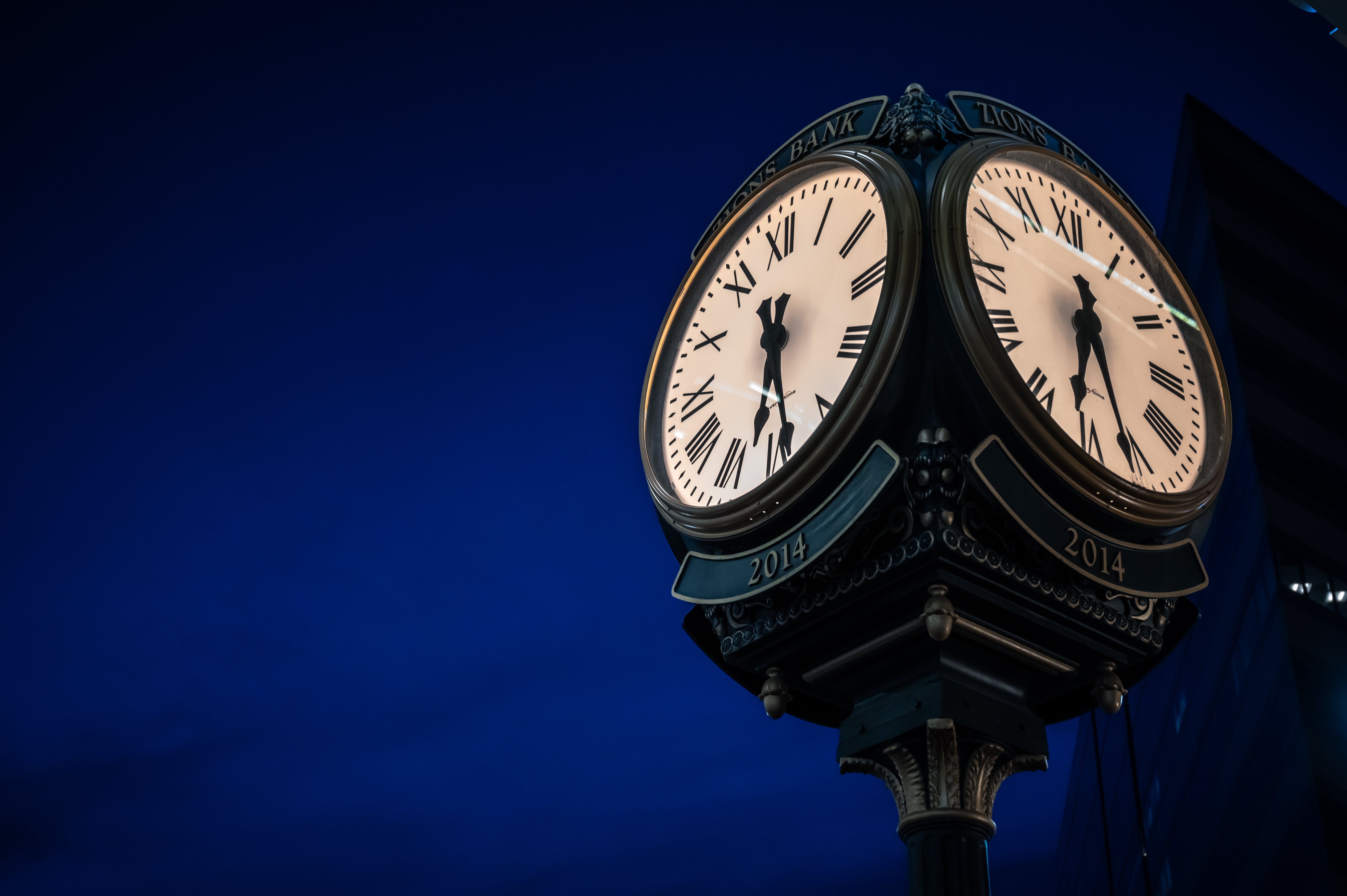 Selective Focus Photography Of Clock At Nighttime
