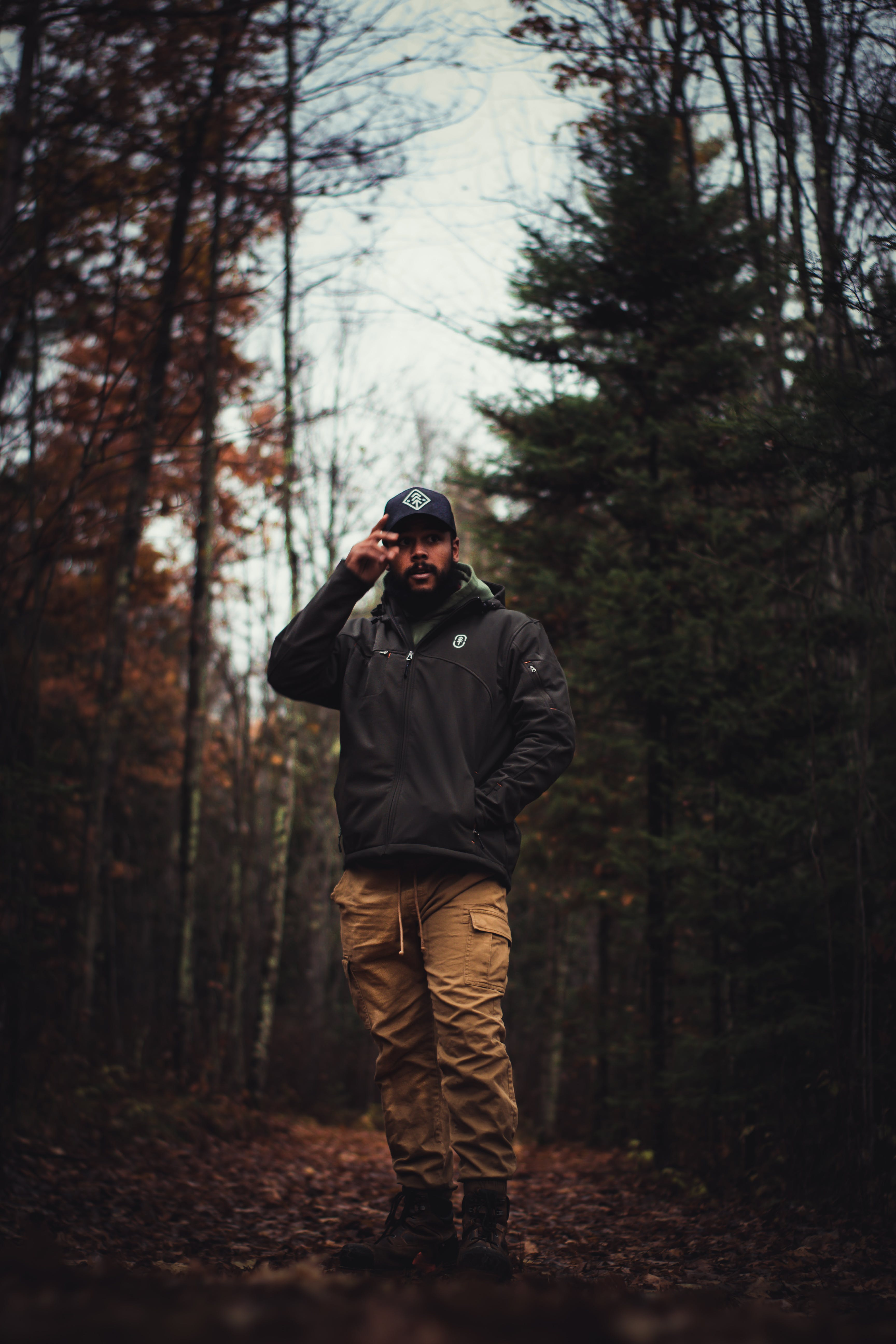 Man Standing on Ground Surrounded by Trees