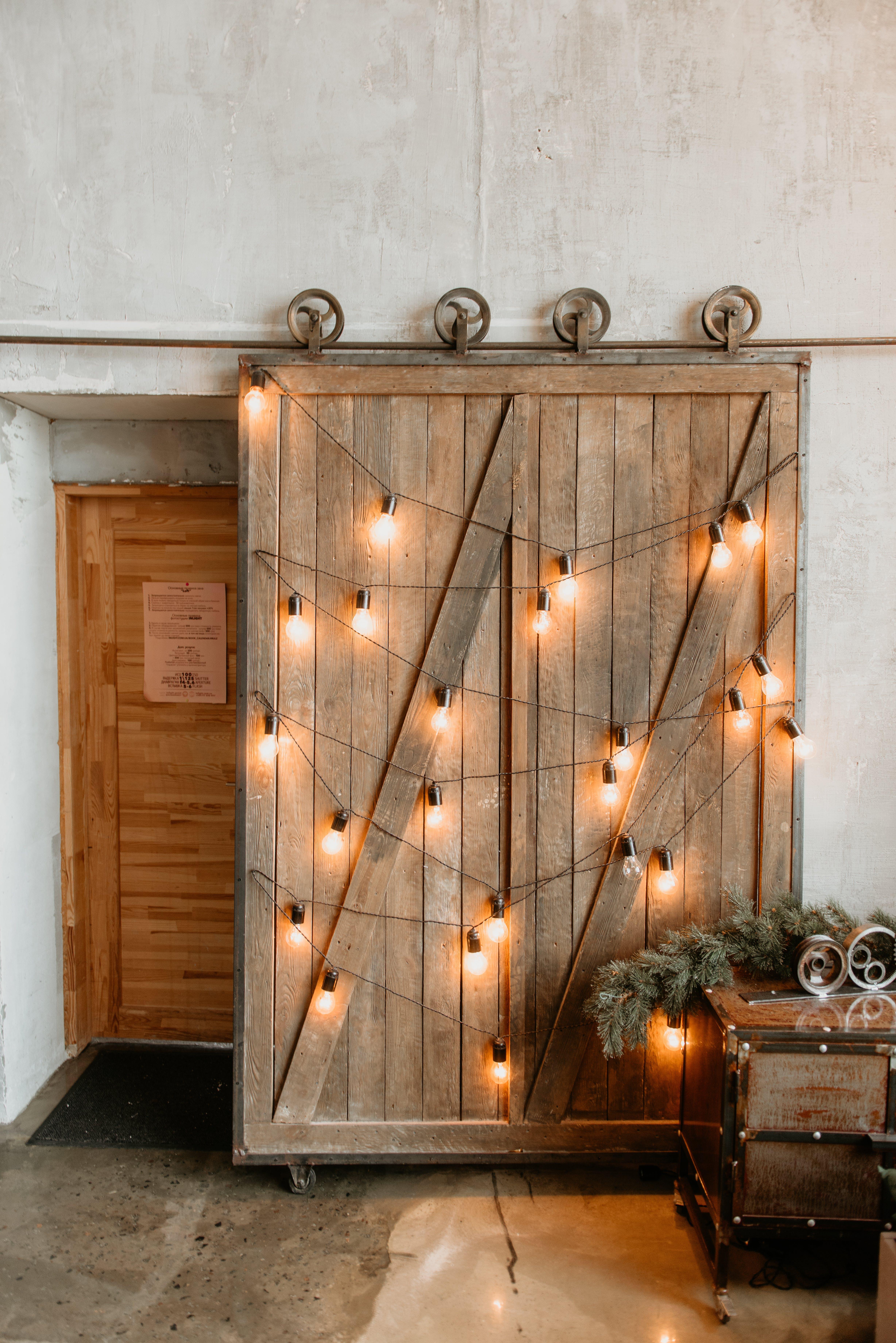 Yellow String Lights On Brown Wooden Door