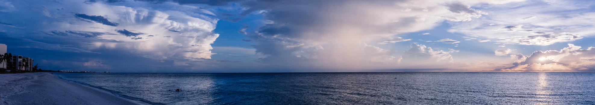 Large Body of Water Under Cloudy Sky
