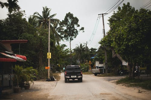 Black Pickup Truck on Road