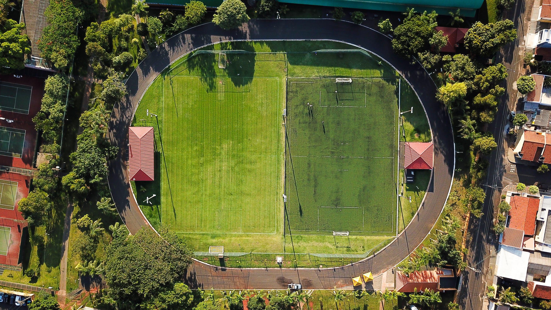 Aerial photography of a Football Field Near Houses