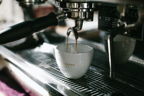 Espresso Machine Pouring White Ceramic Cup