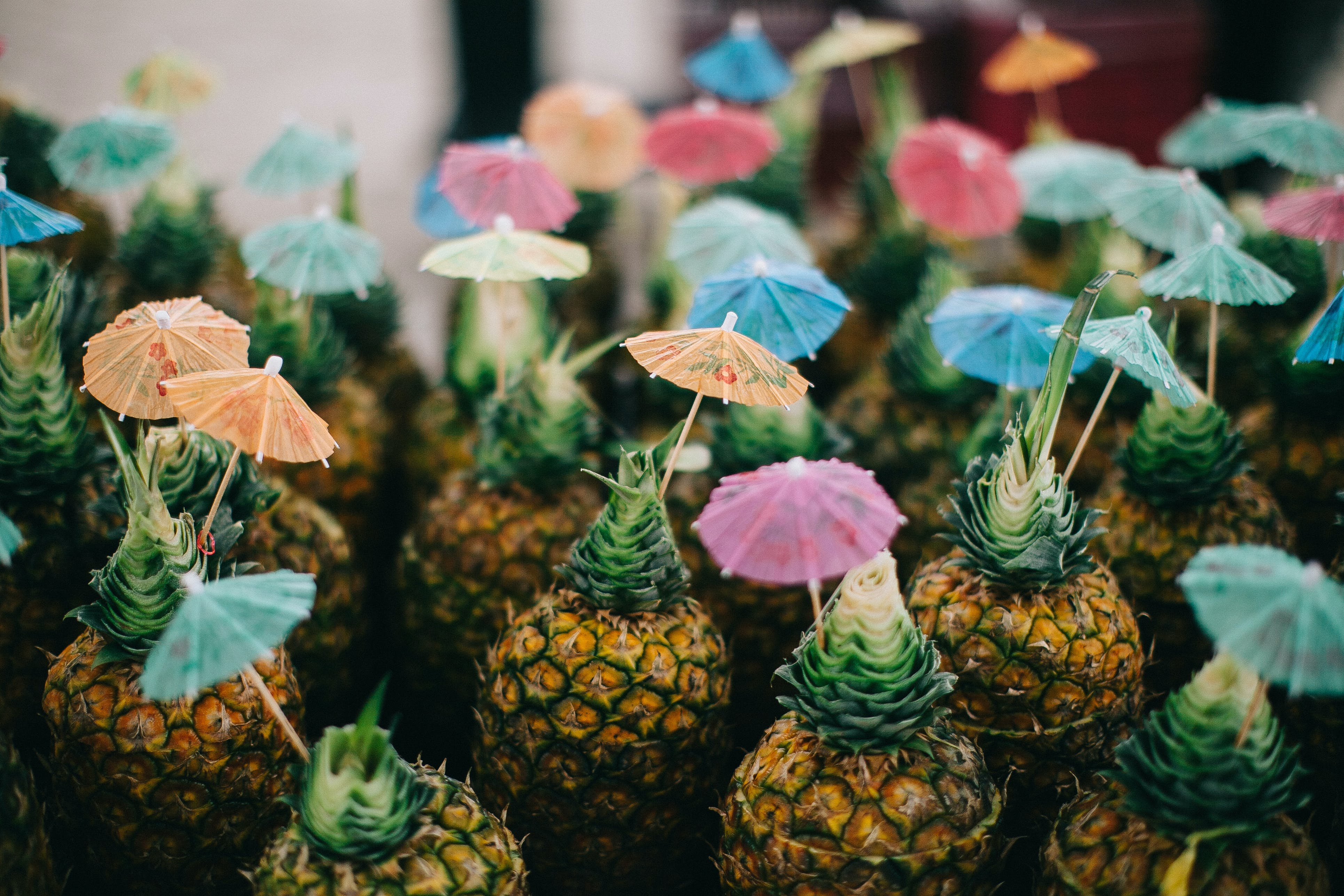 Pineapple Fruits With Paper Umbrellas On Top