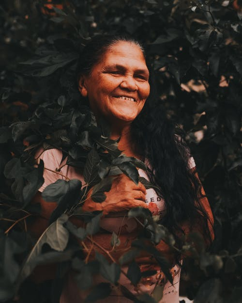 Woman Behind Plant