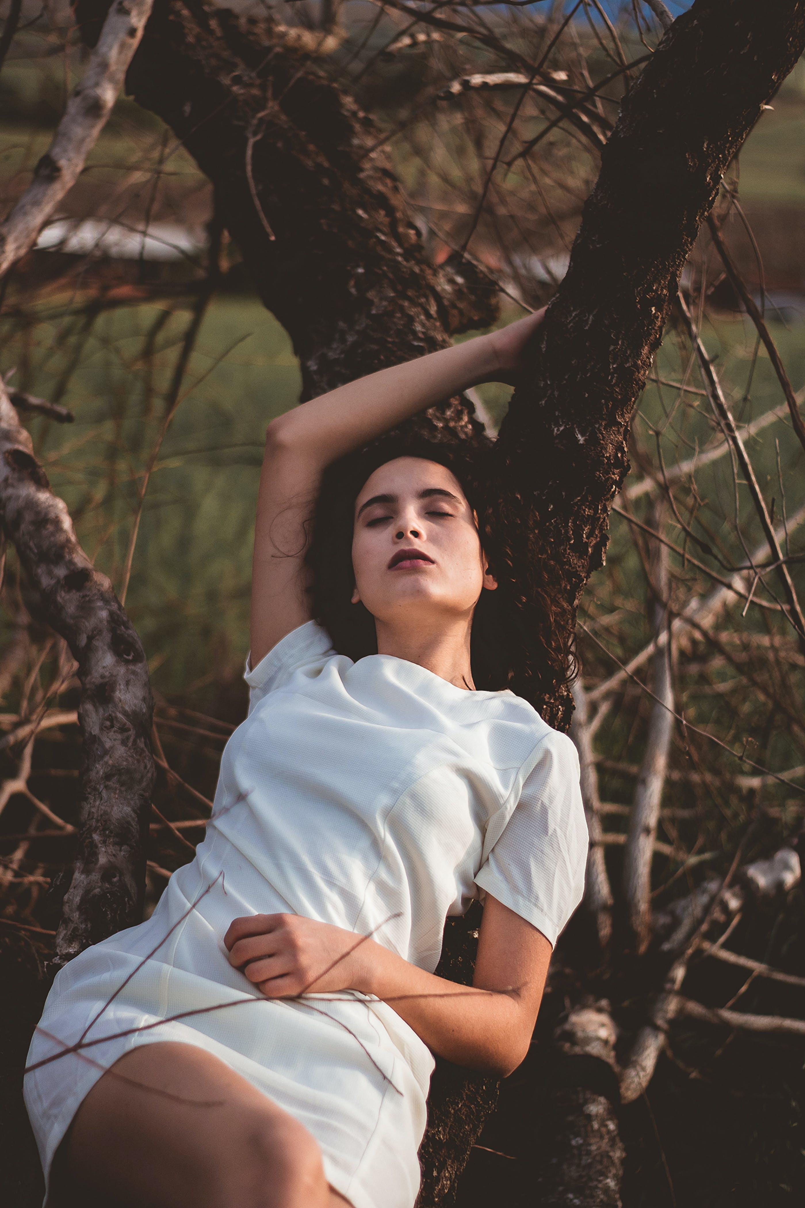 Woman Lying On Tree