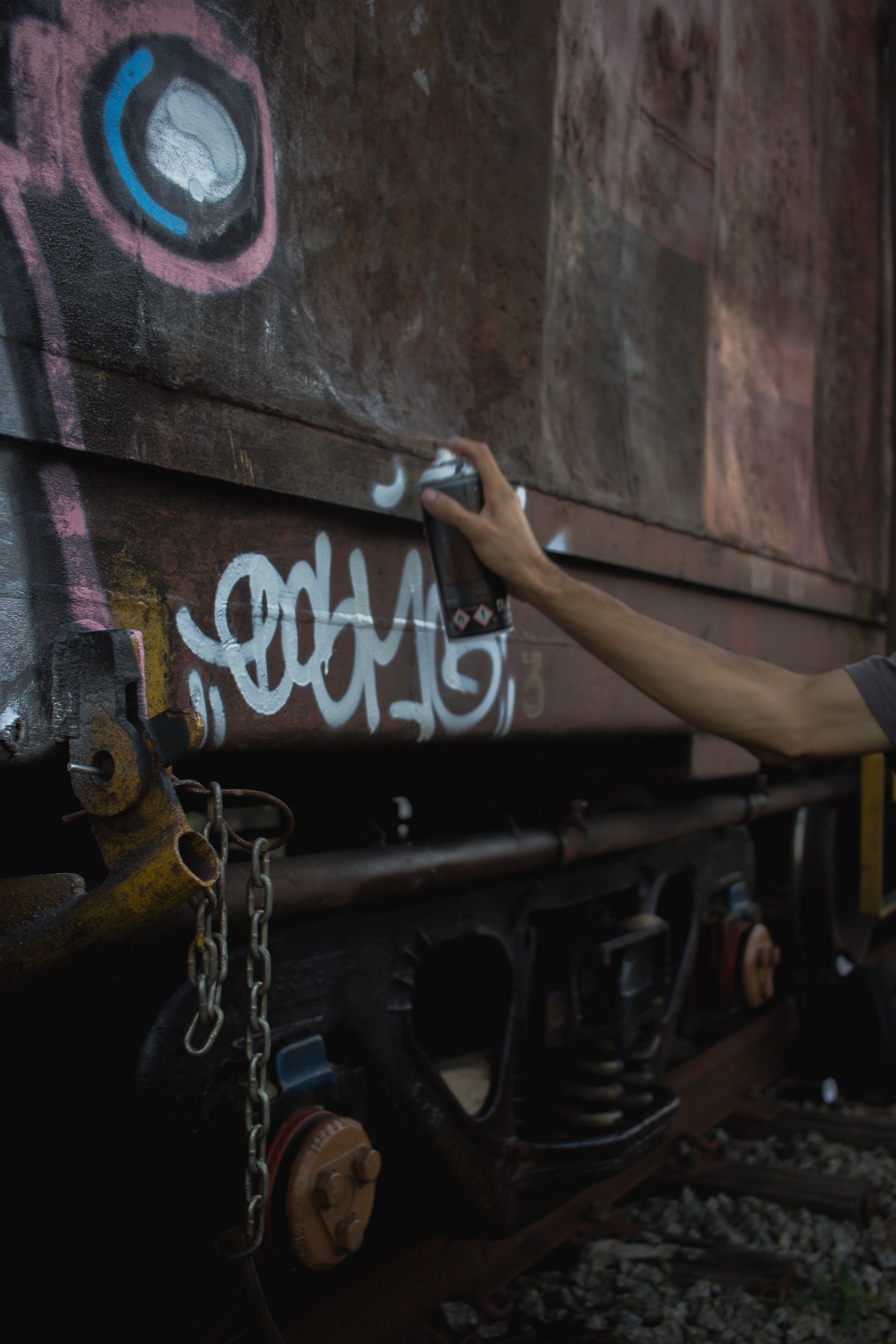 Free stock photo of arm, busking, colors, graffiti