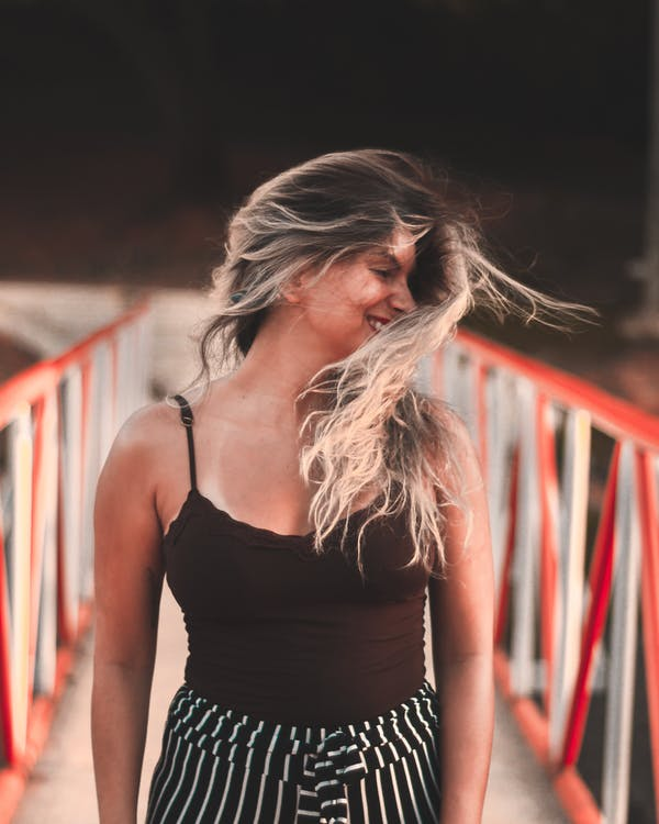 Selective Focus Photography of Woman Waving Hair