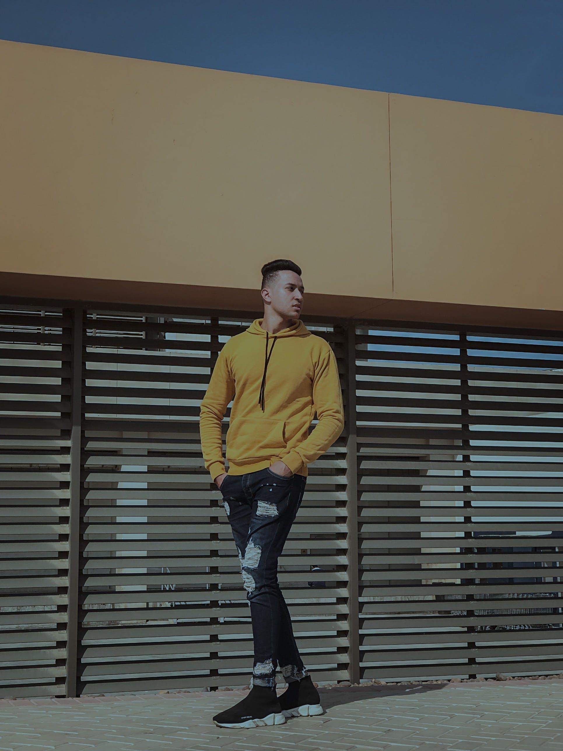 Man Standing on Floor Beside Wall