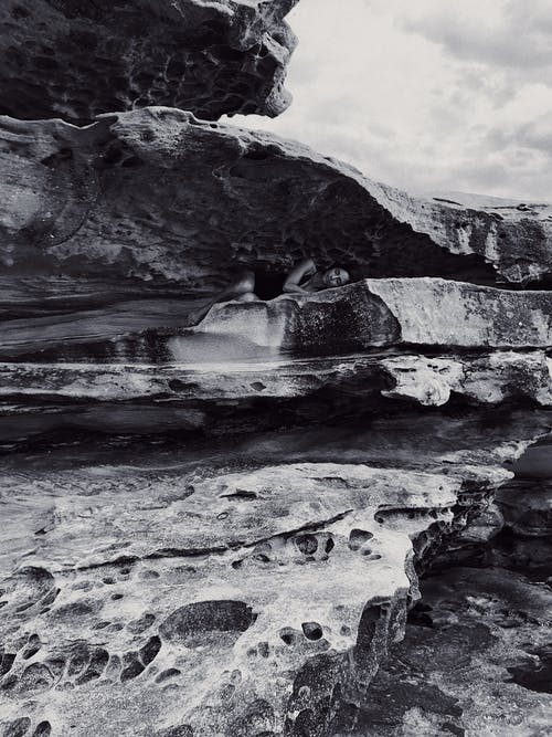 Greyscale Photo of Rock Formations