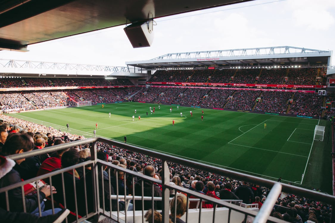 People Watching Football Match