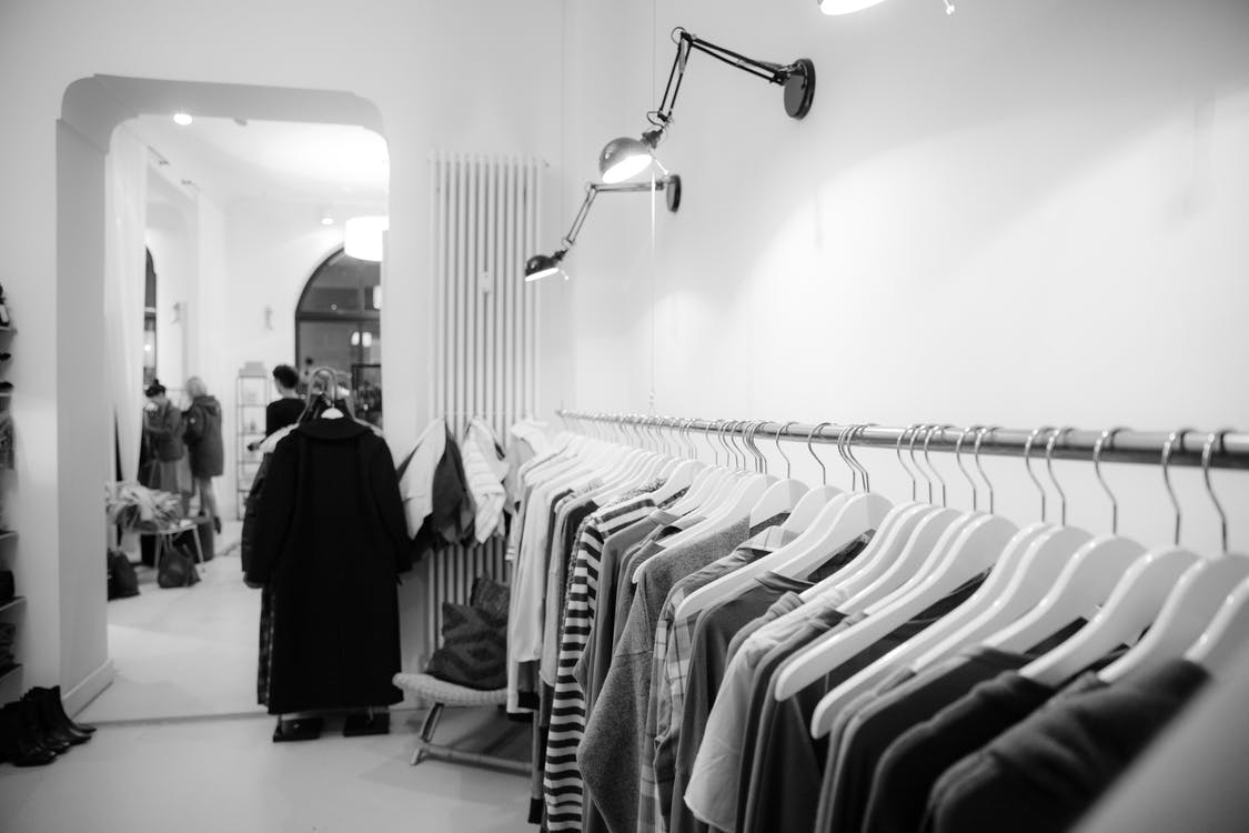 Grayscale Photography of Clothes Lot