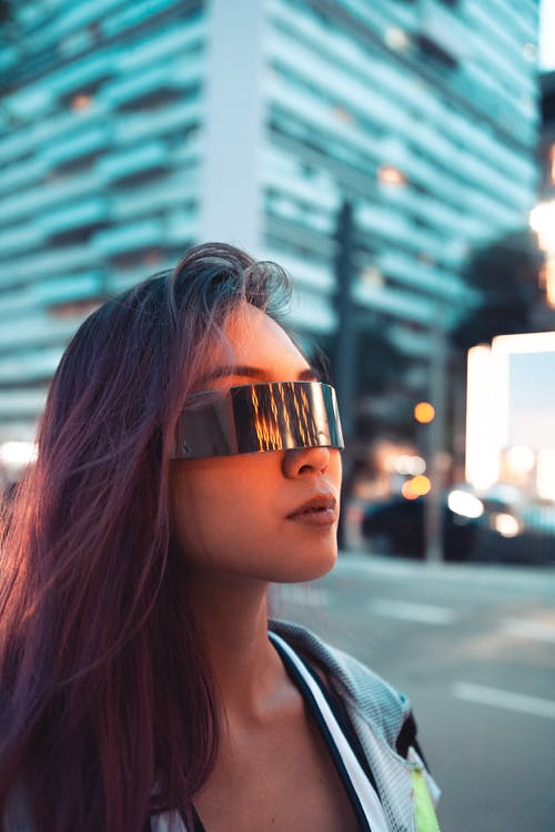 Woman Wearing Sunglasses Walking Near Building