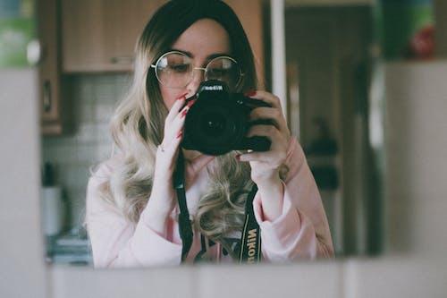 Woman Holding Camera Inside Room