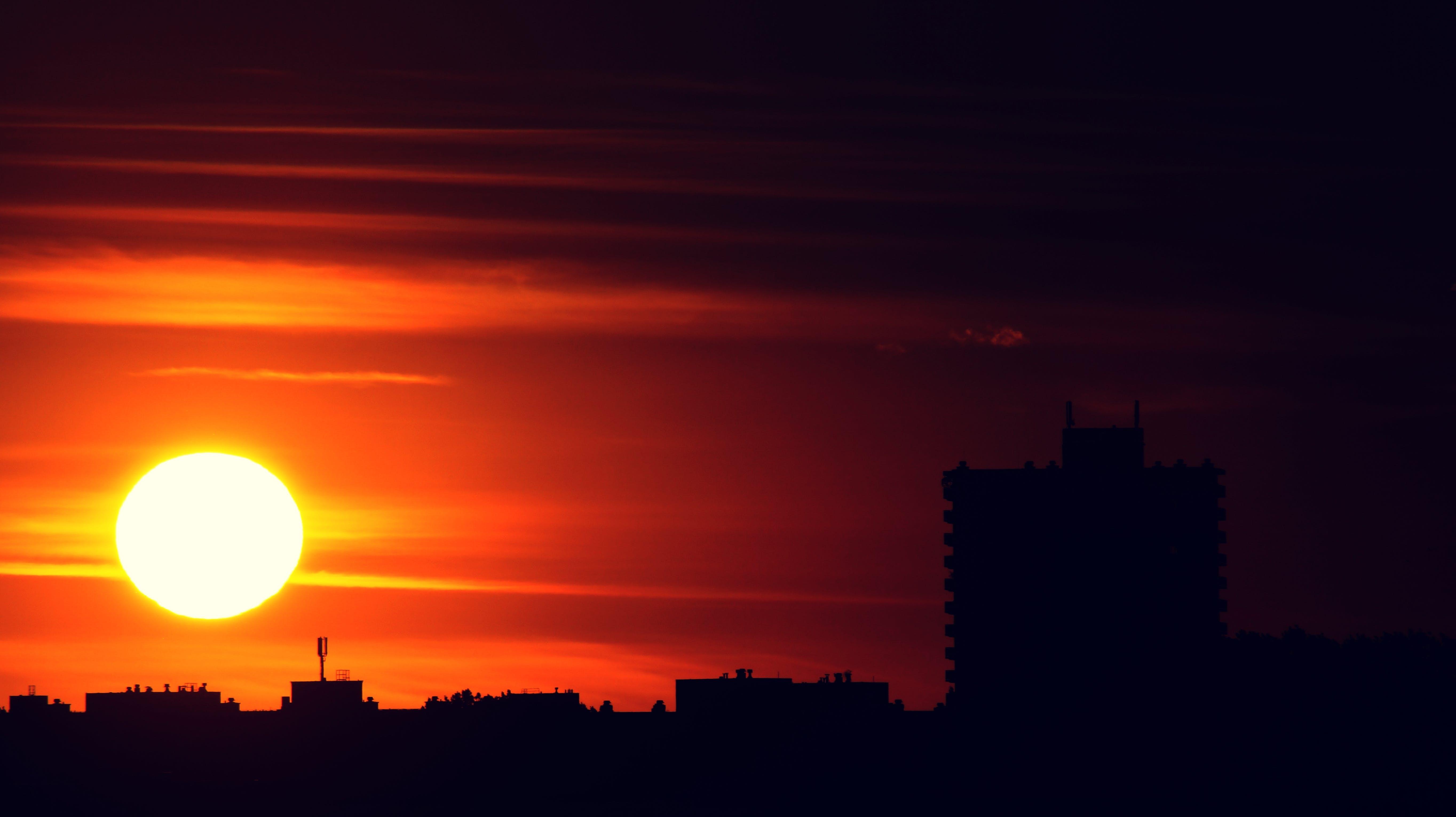 backlit, buildings, clouds