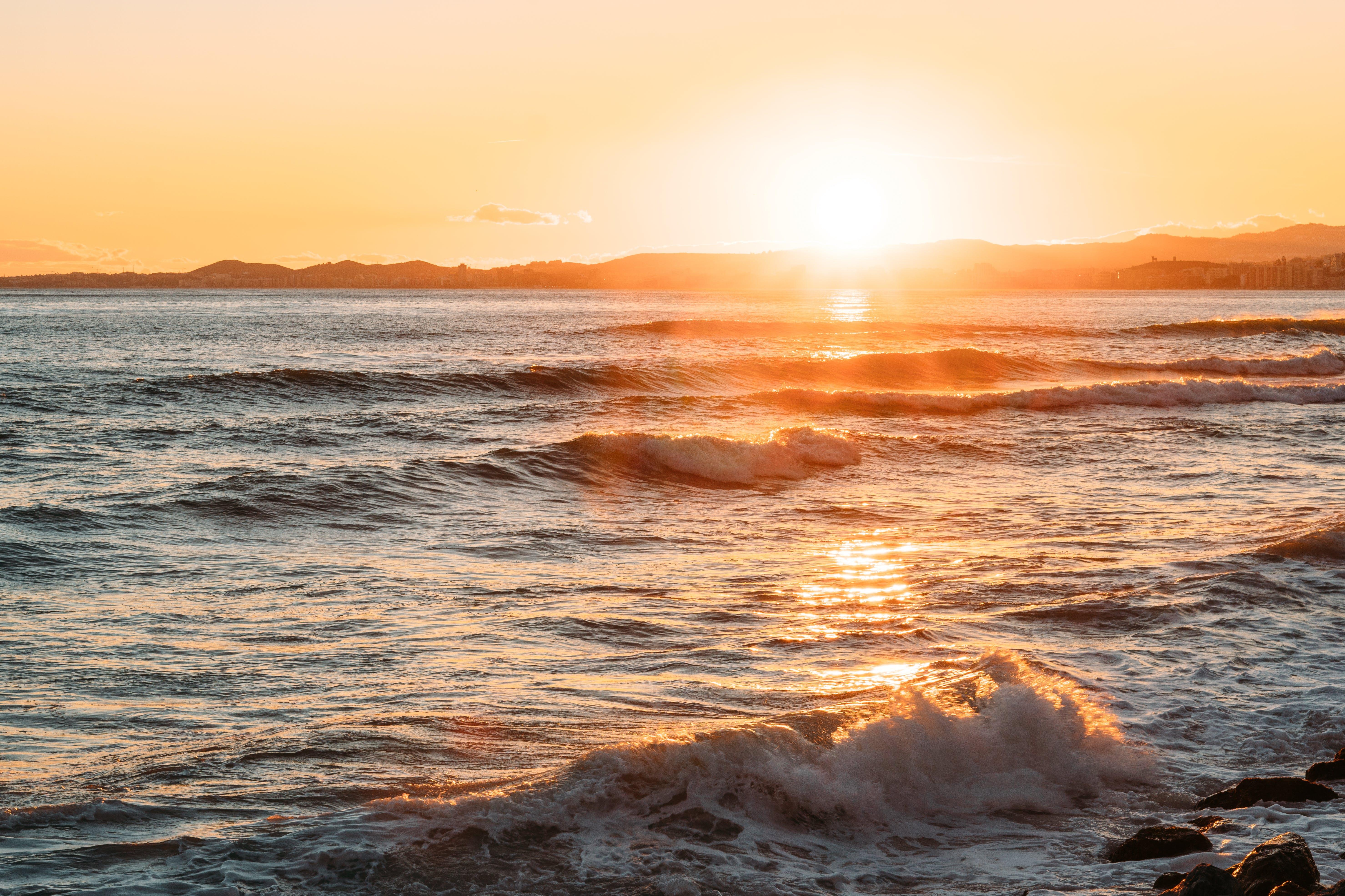 Foto profissional grátis de alvorecer, beira-mar, cênico, exposição longa